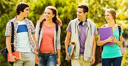 Four students walking together and talking